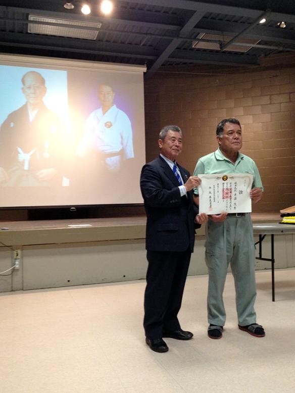 Taira-sensei presenting Akamine-sensei a promotion to 9th Dan, Hanshi.