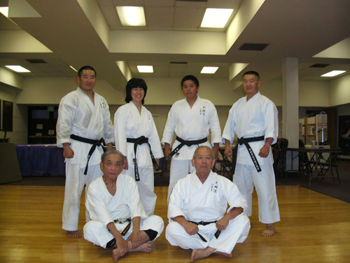 Guest instructor Rei Fujikawa Sensei (seated, left) of Shotokan karate, a former team member of Hidetaka Nishiyama's legendary 1970s kumite team, assists Art Ishii (seated, right) in running a black belt workshop at Art's dojo in 2012. Standing, from left to right, are dojo members Randal Kumagai, Cynthia Nishinaka, Walter Nishinaka, and Russell Kumagai. Photo courtesy of Matsubayashi Shorin-ryu Dojo of Little Tokyo.