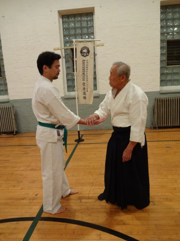 Takehara sensei demonstrates aiki principles with Ravenswood Dojo member Ryan Yokota.