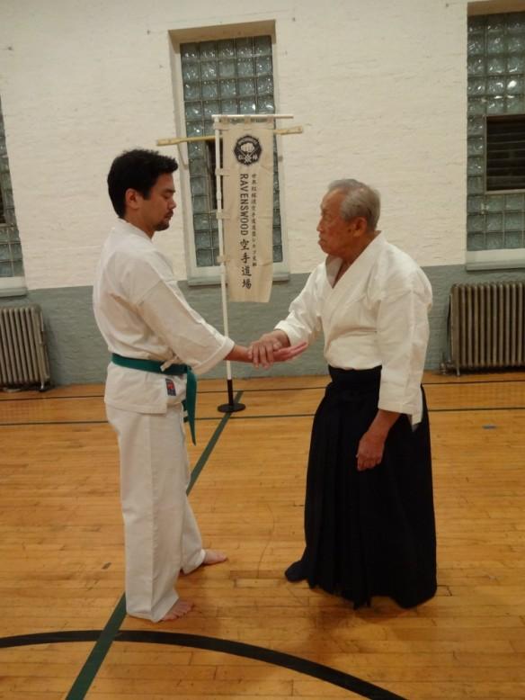 Takehara sensei demonstrates aiki principles with Ravenswood Dojo member Ryan Yokota.
