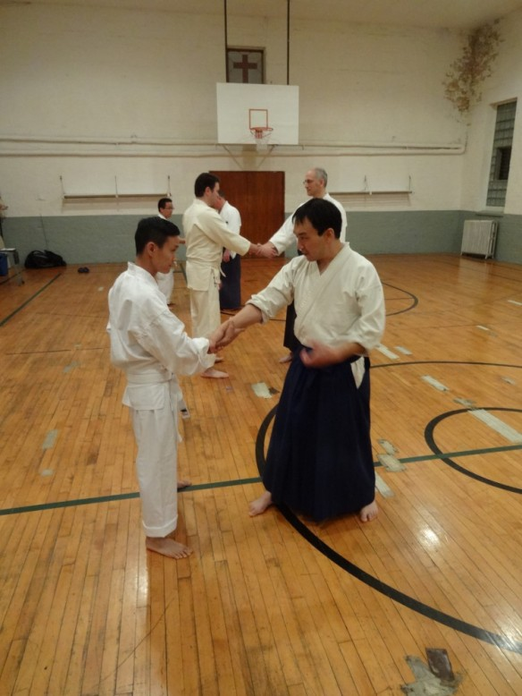 "Special guest Jason Matsumoto, of Chicago-based Ho Etsu Taiko - ""a collective of musicians with a fresh take on the art of Japanese drumming"" - also happened to stop by the dojo for some training. Here he works with Chicago Aikido Club manager Dwight Sora."