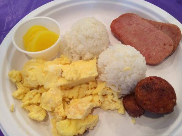 The goods . . . portuguese sausage, scrambled eggs, Spam, rice, and a cup of sliced takuan (pickled daikon radish).